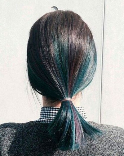 Shoulder-Length Dark Hair with Green Highlights and Purple Overtones
